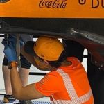 Formula 1: Lando Norris helps out his mechanics after Hungarian Grand Prix
