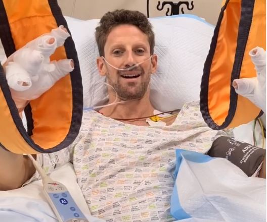 Brave Romain Grosjean smiles from hospital bed after horror crash as he hails halo for 'miracle' escape from burning car